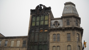 Gotham City in Guelph, Ontario? David J. Knight, editor of a re-issue of John Galt's The Omen, sees Batman's hood -- and part of Guelph's Gothic-Dantesque soul -- in the Petrie Building facade downtown.