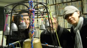 """Sue Smith, David Knight and Gary Diggins with Sue's homemade """"bell tree"""" at CFRU radio station in Guelph, Ontario."""